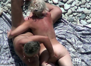 Beach Hunter mature duo playing in the..