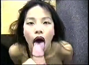 Japanese gal deep throats and gets a..