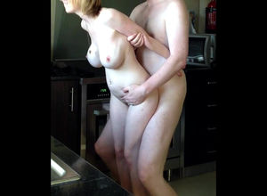 Huge-titted middle-aged gf standing..