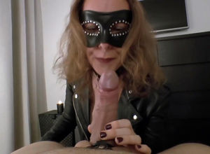 Mature domme in the mask deepthroating..