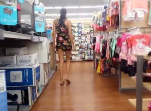 woman raises up her mini sundress in..