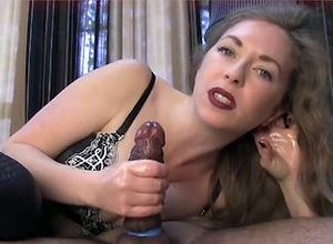 Vicious Cougar doing  hj and footjob..
