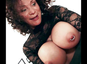 Playful granny with big pierced boobs..