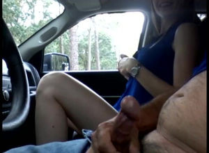 Nymph tugging a cab driver in the car