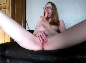 Skinny English nymph tugging on the sofa